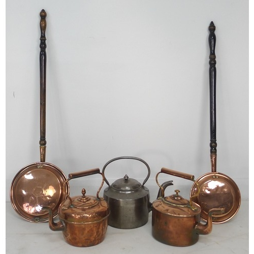 37 - A group of copper items, comprising two kettles and two bed warming pans, together with a large stee...