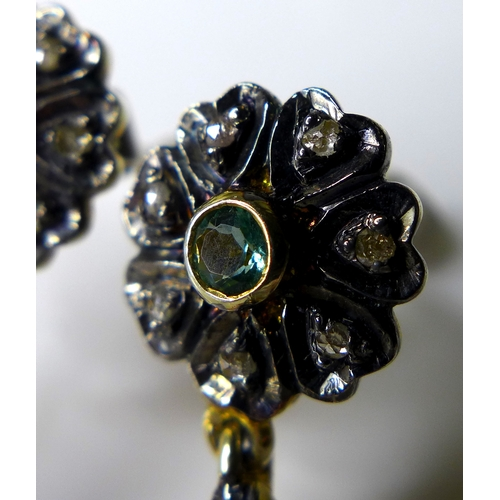 171 - A pair of chandelier style drop earring set with diamonds, flower set to the top with peridot centre...
