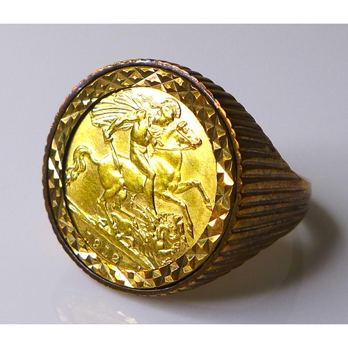 88 - A George V gold half sovereign, 1912, inset within gentleman's 9ct gold ring, size V, 9.5g total....