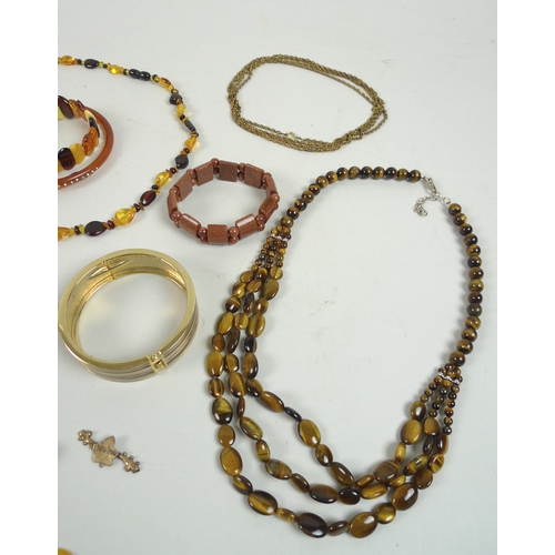 129 - A quantity of amber style costume jewellery, including a set of silver and amber style accessories, ...