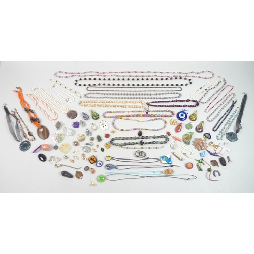 125 - A quantity of costume jewellery, including a large selection of beaded necklaces and bracelets, many...