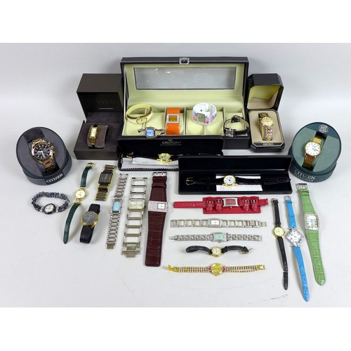 98 - A group of twenty five modern and vintage wristwatches, including a Gucci gold plated lady's wristwa...