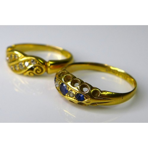165 - Two 18ct gold and diamond dress rings, comprising a five stone ring of two diamonds and three cornfl...