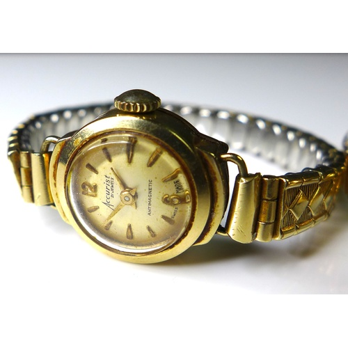 103 - A vintage Velma 18ct gold cased lady's wristwatch, with champagne face and gold coloured batons, tog...