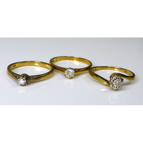 163 - A group of three 9ct gold and diamond solitaire rings, diamonds sized between 0.1 and 0.2ct, size K/...