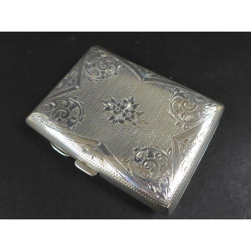 24 - An Edwardian silver cigarette case, with parcel gilt interior, a blank cartouche, Birmingham 1905, 7...