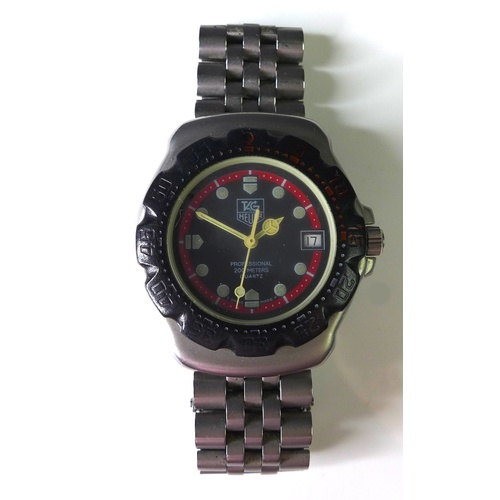 106 - A Tag Heuer Professional 200m steel cased gentleman's wristwatch, circular black dial with red minut...