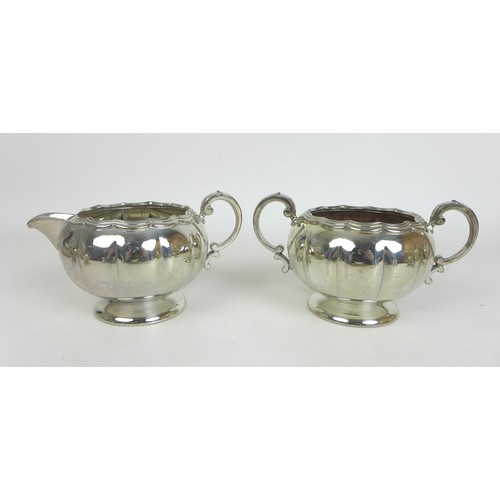 23 - A group of silver plated wares, including a teapot, coffee pot, a pair of gravy boats, and several s...