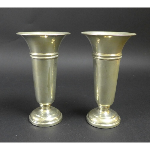 25 - A pair of Elizabeth II silver vases, with weighted bases, Joseph Gloster ltd. Birmingham 1971, each ...