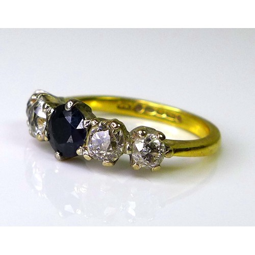 135 - An 18ct gold, sapphire and diamond ring, the sapphire 4 by 4.5mm, flanked by two graduated diamonds ...