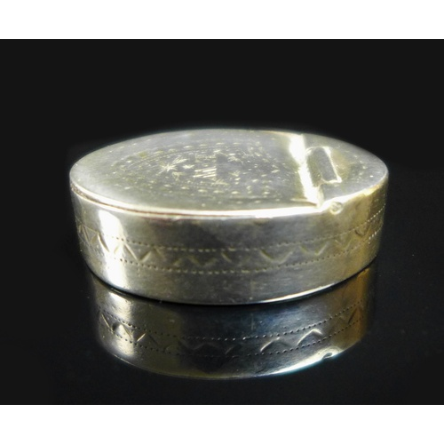 26 - A George III silver oval pill box, with hinged lid, bright cut decoration to lid and sides, bearing ...