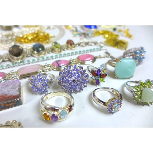 131 - A collection of costume jewellery, including a Wedgwood pendant, a group of silver and semi precious...