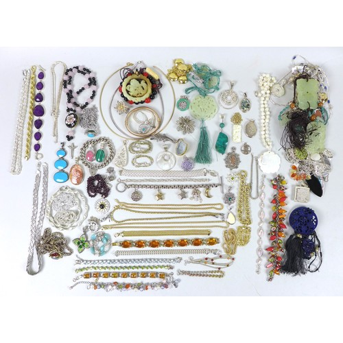 170 - A quantity of costume jewellery, including a mother of pearl carved pendant, a number of jade carved...