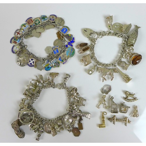 160 - A group of silver charm bracelets, including an example decorated with silver and enamel charms of v...