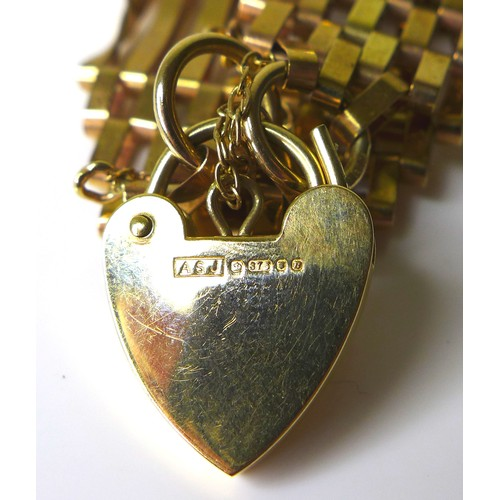 164 - A 9ct gold gate link bracelet with heart padlock clasp, 18.8g....