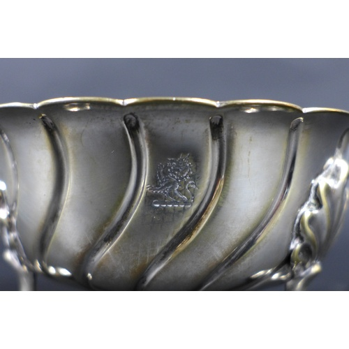 49 - A late Victorian silver circular wrythen fluted sugar bowl, with piecrust rim, raised upon three she...