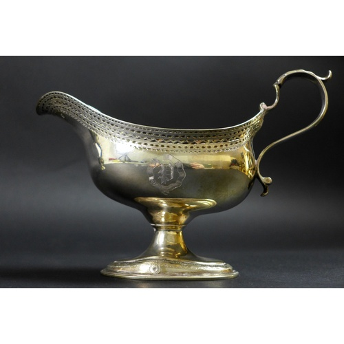 55 - A pair of George III silver pedestal sauce boats, with bright cut decoration and engraved with the i...