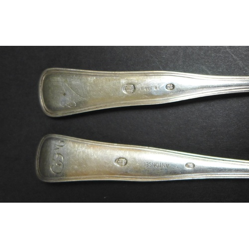 16 - A group of Danish silver and white metal spoons, all with threaded pattern handles, comprising an ea...