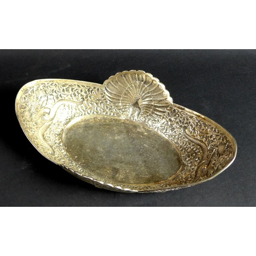 4 - A 19th century Thai silver decorative bowl, of oval form set to each side with a peacock with in ful...