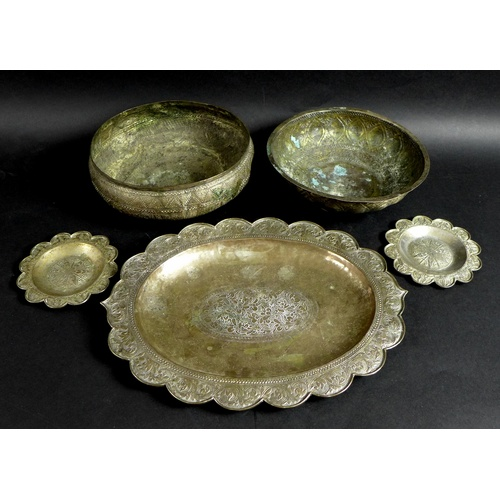 9 - A group of South East Asian white metal, comprising oval tray, 33.5 by 25.5cm, a pair of circular di...