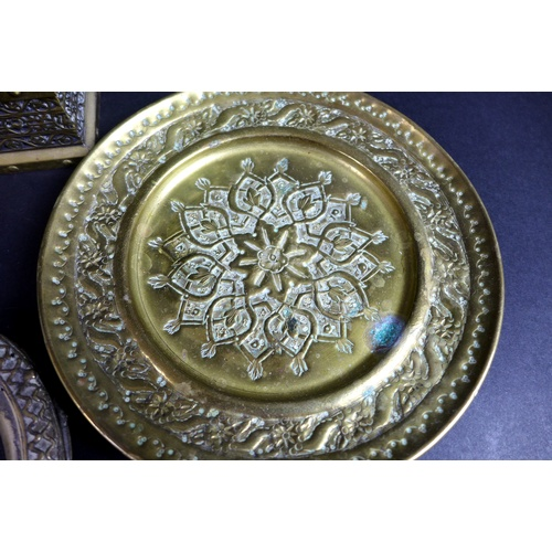 22 - A 19th century South East Asian white metal circular rattle, possibly for livestock, cast geometric ...