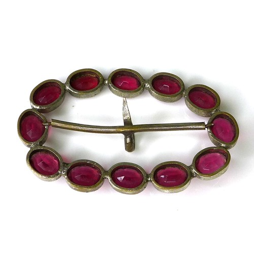 167 - A decorative buckle set with twelve magenta coloured oval 'stones', possibly Georgian, of oval form,...