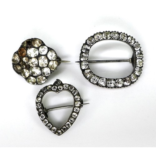 146 - A group of three Georgian and later paste brooches, comprising an open heart shape, open oval shape,...
