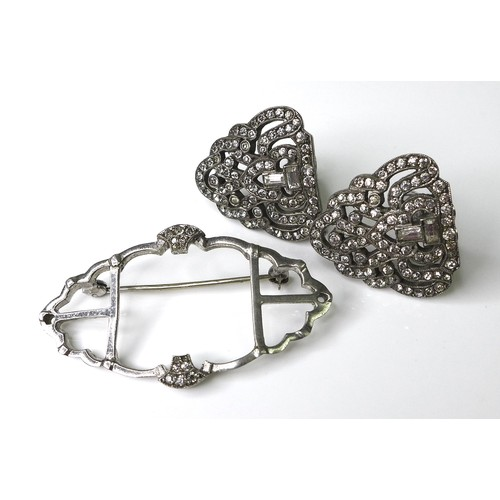 147 - An Art Deco metamorphic brooch, white metal and set with paste, in an open latticework design, conve...