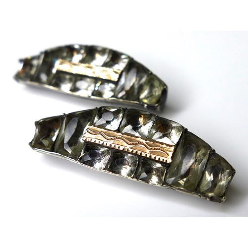 148 - A pair of Georgian paste, silver and gold buckle fasteners, of semicircular design with baguette and...