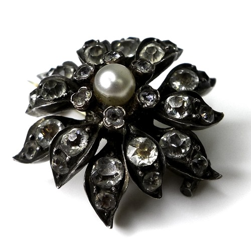 149 - A late Georgian pearl and paste set floral brooch, the central pearl surrounded by individually form...