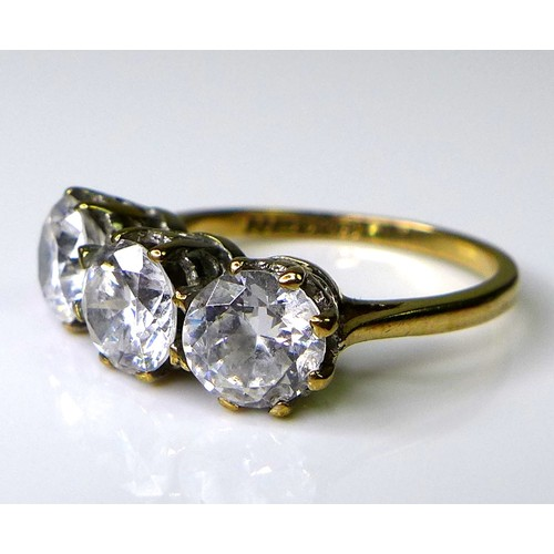 150 - A 9ct gold and paste three stone ring, each brilliant  cut paste approximately 6mm diameter, on a 9c...