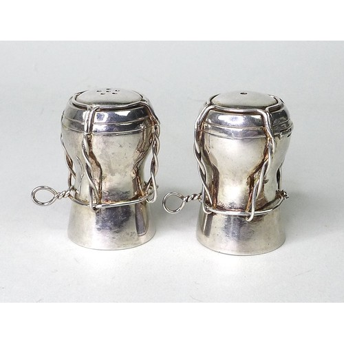 82 - A pair of contemporary silver novelty salt and pepper pots, modelled as champagne corks, AD, London ...