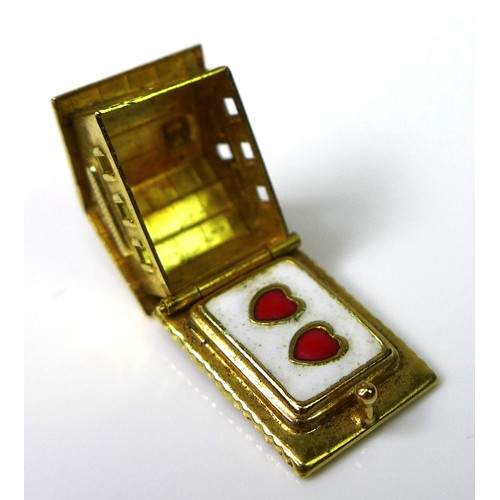 154 - Two 18ct gold charms, one formed as a Swiss chalet, in the style of C. L. Boucher, with hinge openin...