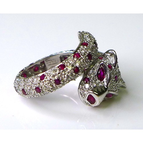 200 - A 18ct white gold, diamond and ruby ring in the form of a coiled panther, by Brooks & Bentley, Londo...