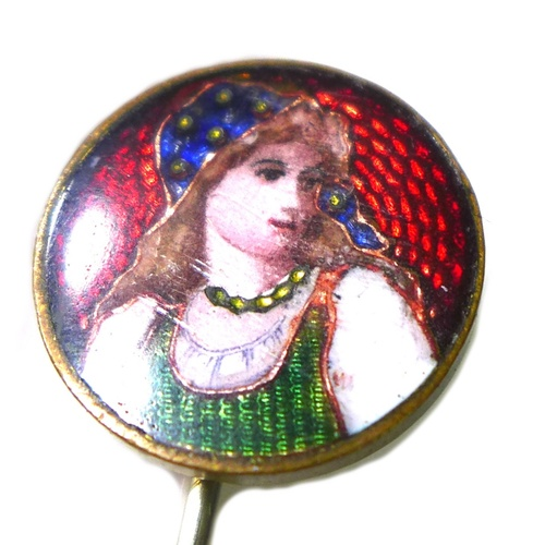 143 - An Arts & Crafts gold plated and yellow metal enamel pin, decorated to the circular head in polychro...