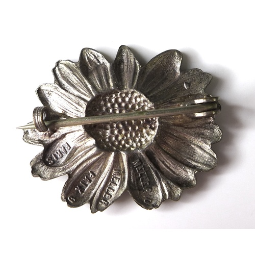 133 - A silver sunflower brooch by Mellerio dits Mellor, stamped to back 'Mellerio Mellor, Paix 9, Paris',...
