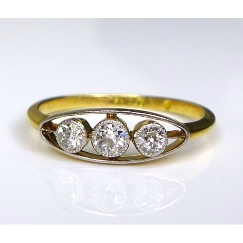 136 - A 9ct gold three stone diamond ring, central brilliant cut diamond approximately 0.06ct, each of the...