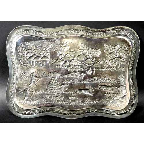 2 - A South East Asian white metal repousse tray, late 19th / early 20th century, decorated in relief wi...