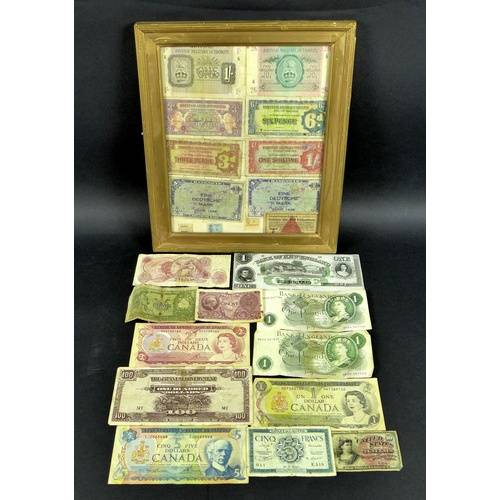 85 - A collection of GB and World bank notes, including One Pound notes, United States Ten Cents Fraction...