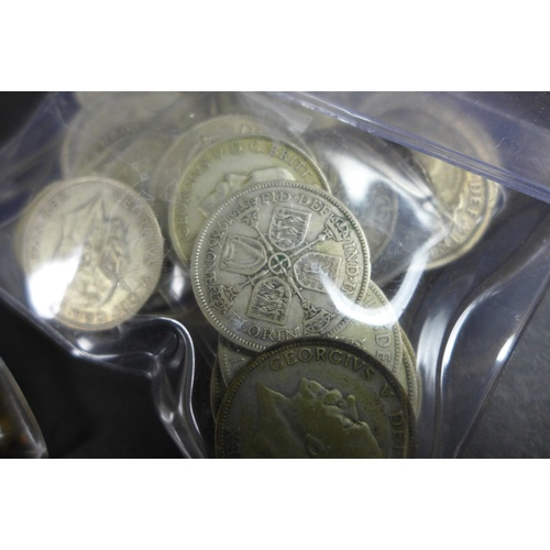 95 - A collection of George V silver coins, 1920-1946, including half crowns, florins, shillings, and six...