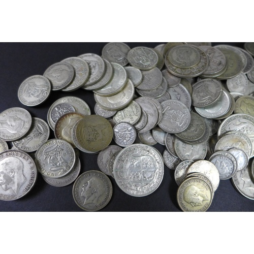 93 - A collection of George V and George VI silver coins, 1920-1946, including 38 half crowns, 44 florins...