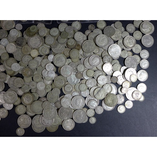 96 - A collection of George V and George VI silver coins, 1920-1946, including half crowns, florins, shil...