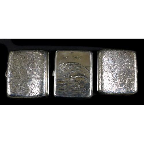 31 - A group of silver items, comprising a George V silver cigarette case, with engraved floral decoratio...