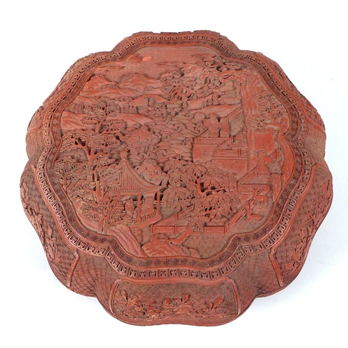22 - A Chinese early 20th century large box and cover, likely red resin, made to resemble cinnabar lacque...
