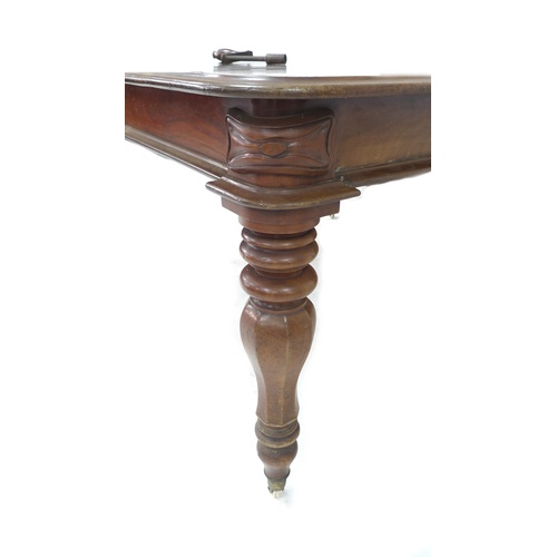 327 - An early Victorian mahogany extending dining table, with four additional leaves, turned legs and whi...