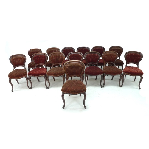 328 - A set of fourteen late Victorian mahogany dining chairs, with shaped and moulded backs, upholstered ...