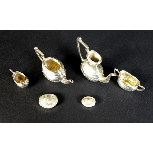 27 - An Elizabeth II silver miniature tea and coffee service, comprising a teapot with lid, 5.3 by 2.2 by...