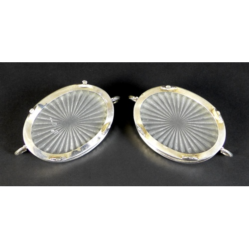 20 - A pair of Elizabeth II silver butter dishes with matching butter knives, of oval form with with twin...