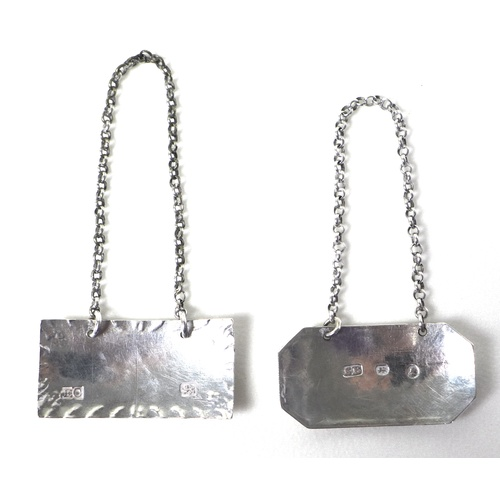 35 - Two Georgian silver decanter labels, comprising a George III silver label of plain canted rectangula...