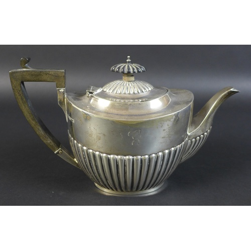 47 - A George V three piece silver tea service, of boat form with part reeded lower bodies, each engraved...